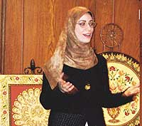 Ronda Kasmiek speaks during the Women in Islam forum held Thursday in Exeter Her mosaic paintings, a take on a 500-year-old art, are in the background