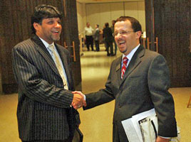 Rabbi Jeremy Schneider greets Azhar Azeez, of the Islamic Society of North America and president of the Islamic Association of Carrollton, at a Jewish service where Mr. Azeez was to speak in November